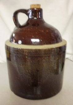 Antique brown glazed stoneware whiskey/ cider jug