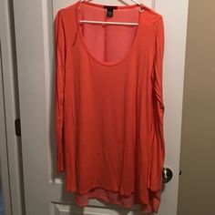 Chiffon back top This is a coral (guys I'm sensing a pattern with my color palette...) long sleeve chiffon back top. It's a longer length, so again, can be worn with leggings. BKE Tops Tunics