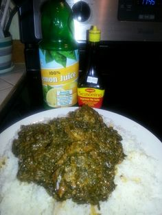 West African food. SOUPA CANJA -tried with Okra, red palm oil, white onion, cassava leaf, red salmon, chicken and beef in jasmin rice!                                                                                                                                                                                 More