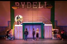 The lockers open as doorways for the opening number. High School Plays, High School Musical, Grease Costumes, Teen Costumes, Woman Costumes, Pirate Costumes, Group Costumes, In Living Color Show, Music Theater