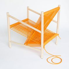 Loom Chair. Laura Carwardine. Seat & back support are created from one continuous piece of orange rope.