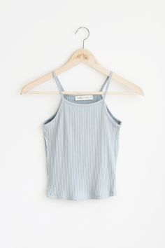 - Details - Size - Shipping - • 95% Rayon 5% Spandex • Spaghetti strap babyrib crop tank top. Opaque fabric with subtle stretch. • Hand Wash • Line dry • Made in U.S.A • Measured from small • Length 1