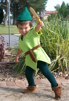 Peter Pan child Costume Faux Lime Green Suede Tunic Green Felt Alpine Hat Red Feather Green tights faux suede belt sword sheath. $249.99, via Etsy.