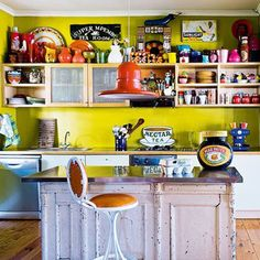 Cheery And Whimsical Kitchen With Colorful Accessories And Green