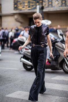 Olivia Palermo wearing black pants and blouse seen outside Elie Saab on day four during Paris Fashion Week Haute Couture FW18 on July 4 2018 in Paris...