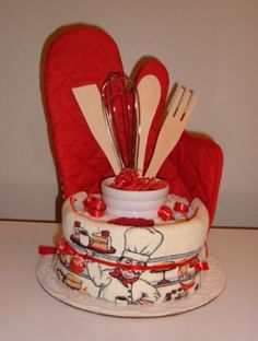 This adorable Pastry Chef themed Kitchen Towel Cake is filled with useful items, and is sure to delight any women on your gift giving list, especially a pastry lover!  This would be an easy DIY gift that would be a great Shower Gift for Bride to be, Birthday, Valentine's Day or Mother's Day Gift, or just because she's so special!