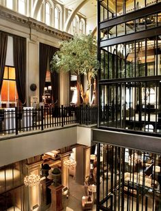 AD 2013 June - Restoration Hardware's Boston Flagship Store - A glass elevator serves the structure's top three floors.