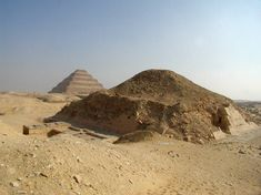 The South West corner of the Pyramid of Unas with Djoser's Step Pyramid in the background._saqqara_pyramid.