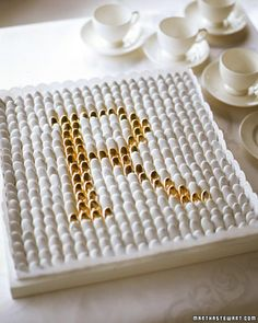 An elegant dagree monogram in white and gold