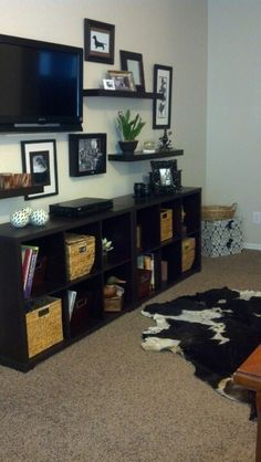 TV gallery wall with cowhide rug