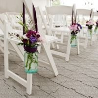jar of flowers on chairs