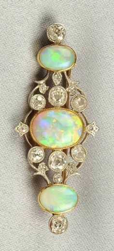 Edwardian Opal and Diamond Brooch, bezel-set with three cabochon opals, further set with old mine-cut diamonds, platinum-topped gold mount, millegrain accents. Edwardian Jewelry, Antique Jewelry, Vintage Jewelry, Antique Brooches, Opal Jewelry, Diamond Jewelry, Fine Jewelry, Diamond Rings, Gold Rings