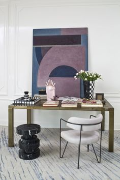 perforated metal parsons table, marble stool, hairpin leg chair, checkerboard vase, pink marble head sculpture with crystal mohawk, wave rughttp://www.kellywearstler.com/studio-collection