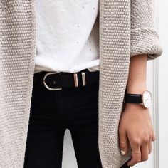 Cream knit cardigan over black skinny jeans and white jeans.