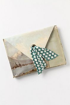 still life clutch - painted envelope canvas purse | Crafted by affixing a vintage oil painting atop a repurposed canvas pouch, this handmade, one-of-a-kind clutch gives new life to a forgotten masterpiece. By Leslie Oschmann for Swarm. Leather, oil and acrylic paint; silk lining #art #bags