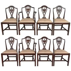 Set of Eight English Hepplewhite Style Chairs (Sold as Set) | From a unique collection of antique and modern dining room chairs at http://www.1stdibs.com/furniture/seating/dining-room-chairs/