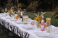 End of summer Dinner Party ...loving this table scape & chairs.  the table covering is paper so that the kids & adults can draw on the table cover as they please w/the crayons adorably provided!