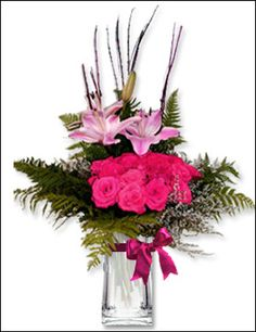 Blooming Beauty - Amazing Birthday Presents Forever  Delicate swirls of pink Lilliums - arranged with matching, pink colored 18 roses - create a vision of splendor in the grass. This beautiful and unusual floral arrangement would make a stellar gift for any occasion, any day of the year.