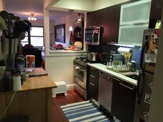 Kitchen area with dishwasher, oven, toaster, microwave and lots of kitchware.