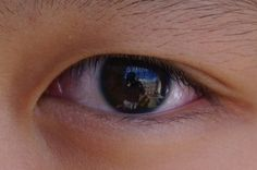 my friends eye, love this photo cause you can see me taking the photo in it :P