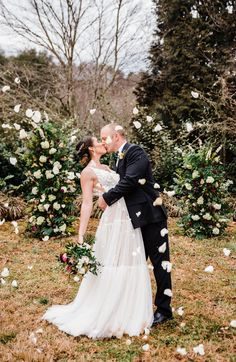 wedding couple surrounded by falling flower petals Wedding Flower Photos, Floral Wedding, Wedding Flowers, Wedding Dresses, Wedding Couples, Wedding Day, Rustic Wedding Inspiration, Fall Flowers, Outdoor Ceremony