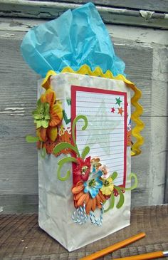 "Petaloo DT member Lynne Forsythe has created a wonderful gift bag and card combo that is the perfect ""Back to School"" gift for your favorite teacher!  See it on the Petaloo Blog   http://petaloo.typepad.com/blog/2012/08/a-gift-for-the-teacher.html"