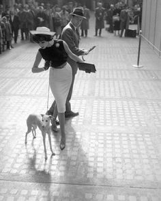 Simone and male model Ward Purdy pose with a whippet dog in Penn Station, New York, 1950s