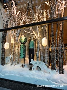 I HEART INTERIORS | Anthropologie: create a winter wonderland in your store front with piles of fake snow and real birch logs. Elegant and impactful.