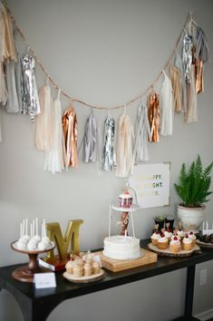 HAPPY : white, gray, peach, beige, copper, & silver mylar party tassel garland