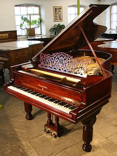 An antique Steinway Model B grand piano with a polished, rosewood case at Besbrode Pianos. 3 year warranty.