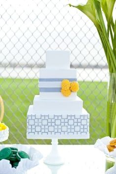 {Grey & Yellow Wedding Cake}  We love these square tiers with a geometric pattern!  Three sugar carnations are so adorable placed on the by isabelle