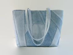 Tote bag, handbag or purse made out of upcycled recycled repurposed denim jeans and cotton fabric is perfect for carrying all your daily