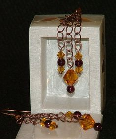 Antiqued copper chain dangle earrings with garnet beads and topaz Swarovksi crystals - pinned by pin4etsy.com