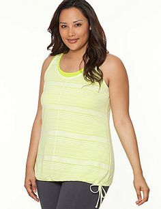 Trendy layering with a sporty twist, our racer-back tank goes from gym to casual looks with sheer burnout stripes and adjustable drawstring hem. Detailed with vertical seaming and a flattering scoop neckline. Shown layered over the matching Ribbed Active Tank (sold separately). lanebryant.com
