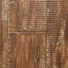 """Amaretto from our Reclamation Plank Collection by Heritage Woodcraft is a hand-scraped (7-7/8"""") wide-plank solid oak hardwood flooring. It's solid construction and wide plank width is achieved by finger-joining three sections of solid oak hardwood together prior to the hand-sculpting of the plank."""