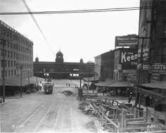 """Market Street at Delaware Avenue, from Front Street. """"By 1906 the construction of the Market Street subway was well under way. The work in progress can be seen at the right.""""--OPEP, p. 75. 1906"""