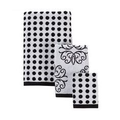 My bathroom is a little random with a pink and white tile shower (which is common in a lot of places here), and a black and white tile floor. I bought solid black and then a range of black and white print towels for the room, including this polka dot set (minus the floral one).