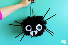 Giant Pom Pom Spiders | AllFreeHolidayCrafts.com