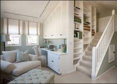 Pared gris y muebles blancos