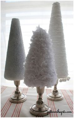 My appliques of choice were scrunched up tissue paper, a thick fluffy yarn, and silver and white glitter. You could also use those little pom pom balls in the kid's craft section, feathers, or a fun festive fabric. They would be really cute in a cable knit fabric or red burlap for texture.
