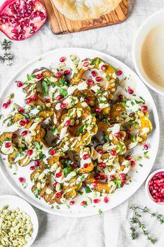 Garam Masala Roasted Acorn Squash recipe from The Ultimate Vegan Cookbook, Photo by Kari of Beautiful Ingredient. #vegan #gluten-free #thanksgiving #holiday #squash #pomegranate #tahini