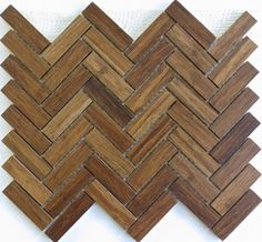 Modwalls sells sheets of mosaic tile featuring eco-friendly bamboo in different shades and shapes, including simple squares and this herringbone pattern.