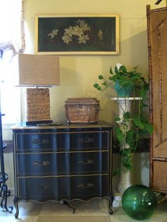 A pretty butler's chest in black and gold paint.
