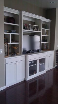 Idea for built-in with glass doors under TV for cable box.