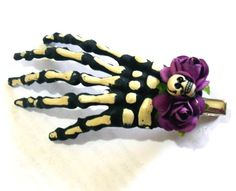 Skeleton hand with purple roses by Dulce Muerte by dulcemuertebows, $3.00