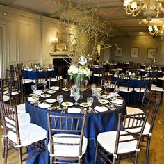 Towering branch centerpieces added visual interest to the reception room. Navy blue linens and cream chair cushions complemented the cozy, natural vibe of the décor.