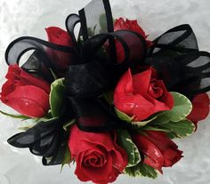 A Beautiful Corsage made of Red Sweetheart Roses with a Black Ribbon is a stunning addition to a perfect dress. Design by Westchester Flower Shop. #portchesterprom #westchesterflowershop #corsage #westchester #prom