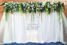 Beautiful backdrop flowers over white fabric ready for wedding ceremony   Stock Photo