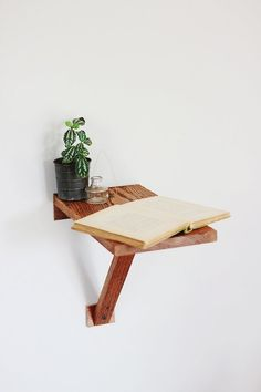 this is SO EASY and SO CHEAP to do.  one wall bracket, one scrap of wood = instant side table