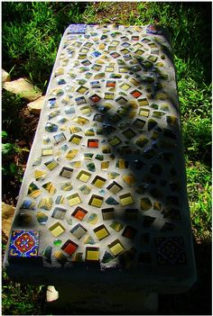 Pretty and it would be easy to do. A small bag of cement, broken pieces of ceramic tile, and some marbles...